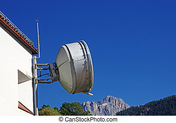 everywhere communication - an antenna hanging on a house on...
