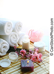 Body care - Cream, flowers, candle and towels for detente