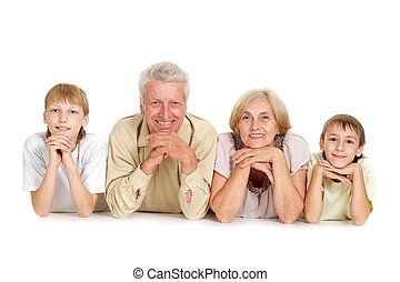 Grandparents with their smiling grandchildren