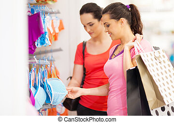 woman shopping for lingerie - two young woman shopping for...