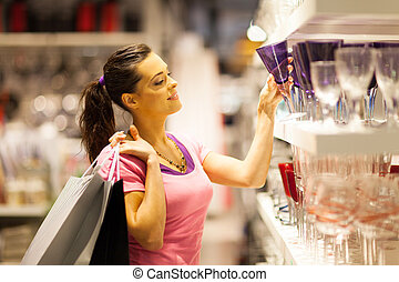 young woman shopping for glass
