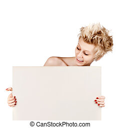 Beautiful young blond girl holding blank white sign with copy space.