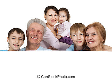 Happy Caucasian family of six people holding the paper on a...