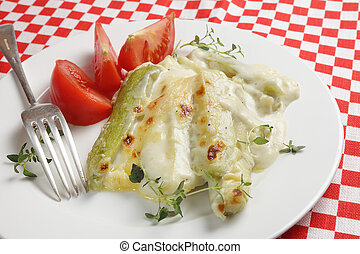 Courgette in bechamel sauce - Courgettes baked in a garlic...