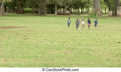 Happy children playing soccer