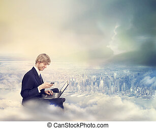 Man with Laptop and Phone on Top of the City - Young...