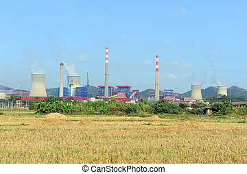 Industrial landscape with chimneys tank