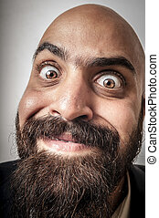 elegant bearded man with jacket and funny expressions on...