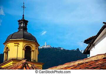 Yellow Church and Monserrate - A yellow church in Bogota...