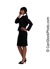 An African American businesswoman over the phone