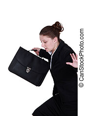 secretary holding briefcase trying to keep her balance