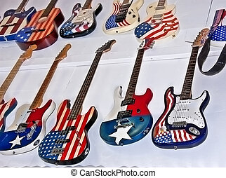 American Flag Motif Guitars - This display of guitars, both...