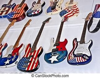 American Flag Motif Guitars - This display of guitars, both...