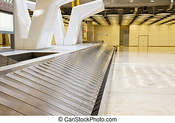 Baggage claim area - empty modern luggage band in the...