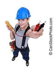 female electrician holding a measurement tool