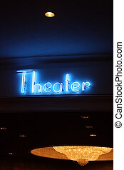 Neon Theater Sign - A blue neon theater sign at night
