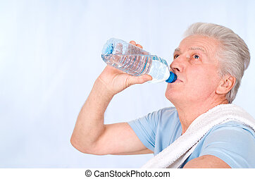 old man drinking - cute old guy with bottle of water
