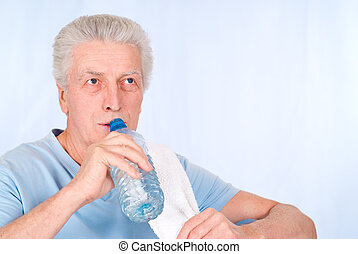 old man drinks water - cute old guy with bottle of water