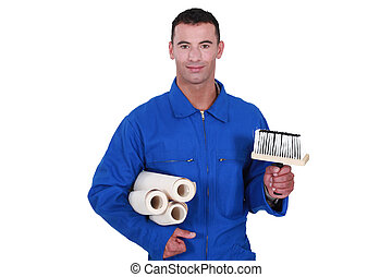 craftsman painter holding brush and wallpapers