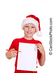boy with list - portrait of a kid in santa hat with list