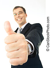 Success in business - Close-up of thumb up on the background...