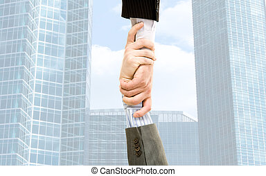 Handshake of businesspeople on the background of the modern...
