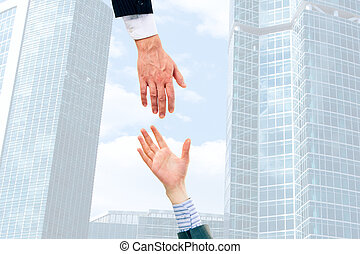 Giving hands - Image of two businesspeople giving hands each...