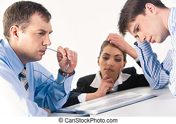 Brainstorming - Image of three professionals thinking about...