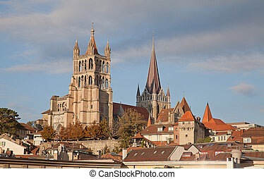 Lausanne - Sunset over ancient cathedral in Lausanne,...