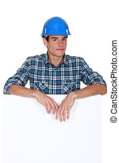 Handyman behind white panel