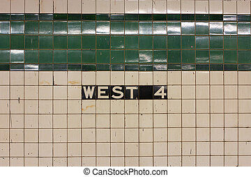 West 4th Station Sign - Sign on the tiled wall in Manhattans...