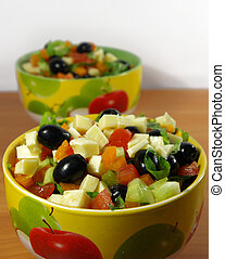Greek salad in a bright plate - The Greek salad in a bright...