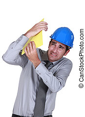 Engineer shielding himself from a blow