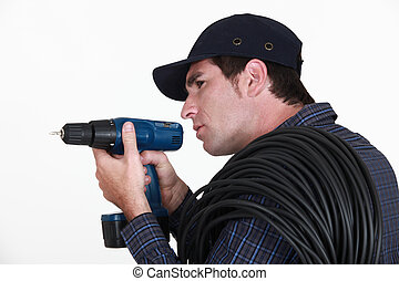 A man holding a drill.