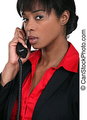 Businesswoman using a landline