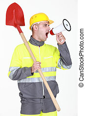 Construction with shovel shouting into megaphone