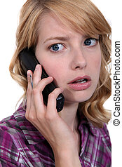 Shocking woman on the telephone