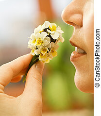 Woman smelling the flowers - Woman smelling a small...