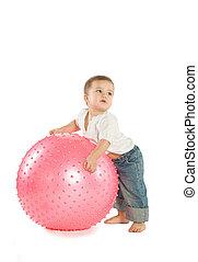 Boy with a fitness ball - A little boy with a big pink...
