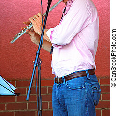 Flute player. - Flute player performing in concert.