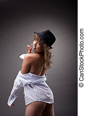 Sexy young girl undress white shirt in striptease - Sexy...