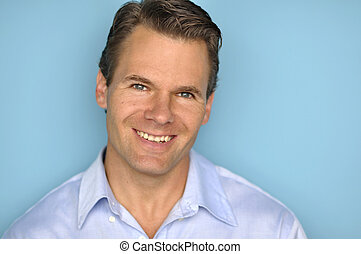 Handsome Caucasian man - Headshot of smiling Caucasian man...