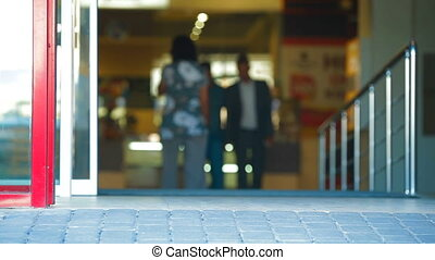 Shopping Mall Entrance - People Walking Through the Doors of...
