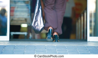 Supermarket Shoppers - People with Shopping Cart Walking...