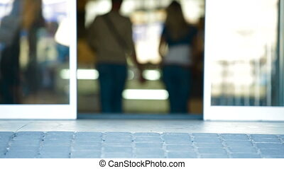 Walking Through The Glass Doors - Group of People Walking...