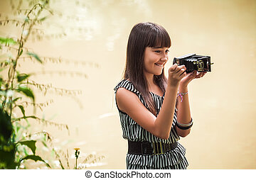 Girl with antique camera