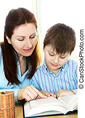 Tutoring - Teacher or tutor helping school boy to study