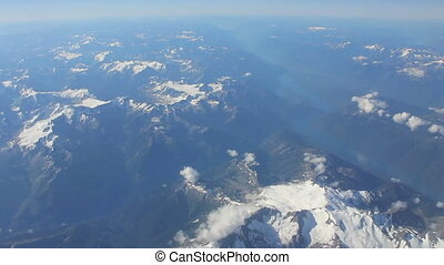 Flying Over Canadian Rocky Mountain - An aerial view of the...