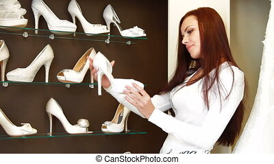 Buying a Wedding Shoes - Young attractive woman buying...