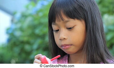 Asian Girl Enjoys A Popsicle - A cute little 6 year old Thai...